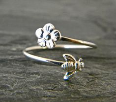 I love this pretty ring. Made of 16 gauge sterling silver wire, designed to wrap around your finger, each end is finished. One with a silver flower and the other a delicate silver tiny bee. This ring is finished in the tumbler to give it added strength and a nice shine. This ring is not intended for everyday wear, but more as a statement or special piece to enhance an outfit and special occasion. Included with your order is a complimentary, treated silver and gold polishing cloth. This is…
