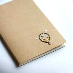 Hot Air Balloon hand embroidered moleskine pocket by PoppyandFern, $12.00