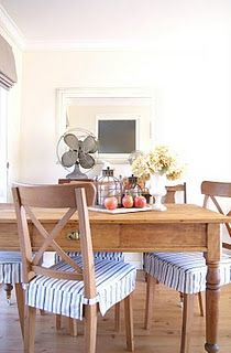 Ticking stripe chair cushions.