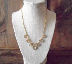 Vintage gold metal necklace with mini rings by SchoolofVintage, $26.00