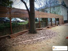 Building a modern wood privacy fence in the backyard.