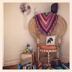 My living room. Most of this will be for sale. Email classicrockcouture@gmail.com for photos and pricing. Boho chic decor, gypsy, living room, vintage peacock chair, crochet shawl as throw, woven wall art, antlers, vintage concho hat, southwestern aztec rug. Total bohemian hippie gypsy style home.