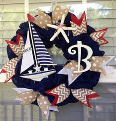 www.facebook.com/cutecraftsbyash Made by Ashley Hughes navy blue nautical wreath with red and white accents. Coastal Wreath, Nautical Wreath, Beach Wreaths, Wreath Crafts, Diy Wreath, Burlap Wreath, Anchor Wreath, Letter Wreath, Summer Wreath