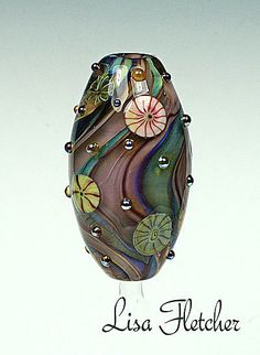 Glass bead made by Lisa Fletcher.