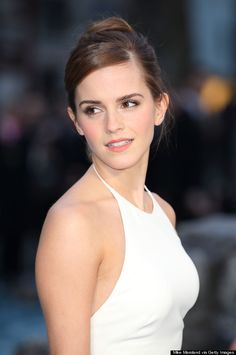 Emma Watson Stuns In White Backless Gown At 'Noah' Premiere