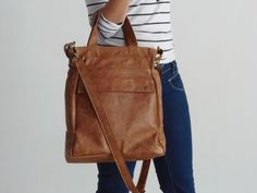 AVAILABLE IN MORE COLOURS The multi purpose tote bag is a new design for Fall -14 . It is a very functional leather tote bag as it has 11 pockets in total