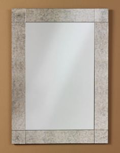 351 – Rectangle Frameless Mirror features a clear mirror with a 3 1/2″ wide antique mirror overlay border. 24″ wide, 34″ high and 1/2″ deep.