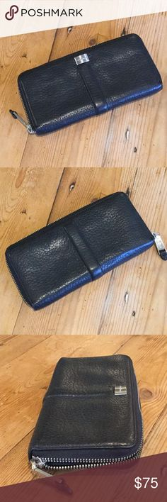 "Cole Haan Black Leather ZIp Around Wallet NWOT NWOT Cole Haan Black Leather ZIp Around Wallet, in new condition.  Approx 8"" long, 4"" wide, 1"" deep.  Happy to answer questions, thanks!❤️ Cole Haan Bags Wallets"