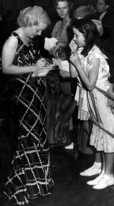 September 18th 1934 Bette Davis signing An autograph for a young fan
