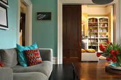 Eclectic Living Room by Shannon Malone You can find original pocket doors in many Craftsman and Victorian homes. These built-in features come in handy for separating two adjoining rooms when you need privacy or quiet. When not in use, the doors slide into the walls, leaving a wide (usually at least double-width) opening.