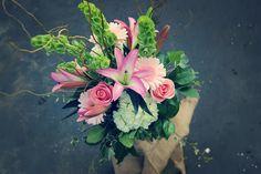 Rosemary Duff Florist | flower arrangement | floral design | event flowers | burlap | pink roses | pink lilies | greenery