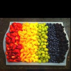 Rainbow Fruit Tray- marshmallow clouds And chocolate fountain by Denis D-L