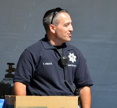 Officer Fekete at the Public Safety booth in the 2012 Arts & Wine Fest talking about the Explorer program.