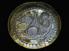 Ancient Sasanian silver and gold dish showing a griffin, currently located at the British Museum, London.