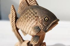 Figurine The Fish. Woodcarving. Completed and painted by hand from an array of wood, will become an unusual and touching decoration of the interior. A wonderful gift for a child or a girl, a woman, an animal collector, a fisherman. Like all my carvings, it is a unique piece, made entirely by hand with the chisels and wooden knives, carved on a linden wood. I specifically use only dried wood for my sculptures, so the resulting work is very stable and will not develop cracks over time…