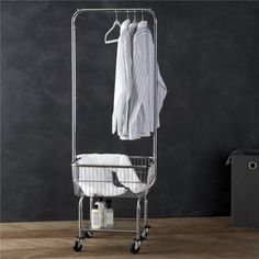 Laundromat-style rolling cart with generous chromed basked and hanging bar makes it easy to sort, move, fold and put away laundry.  Lower shelf stows detergent, bleach and other laundry supplies. 66. 2% metal, . 95% plastic, 20. 4% plastic wheels and 12. 45% polyesterClean with a damp clothMade in China.