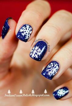 Love these nails! Blue sparkles with a simple snowflake.
