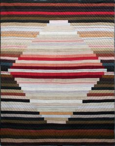 Archive: Vintage Strip Quilt    The Volckening Collection recently acquired a second quilt from eBay. The quilt (pictured above) is a vintage 20th century center medallion strip quilt featuring earth tones, neutrals and a splash of red. The quilt was probably made in the later 20th century - feels like 1970's or 80's - and is unusual because of its center medallion design.