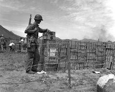 Private First Class Sterling G. Patterson, of Eagle Rock, Cal., has a real security job. He is shown standing guard on beer rations for Marines in Korea. Korean Peninsula, See The Sun, War Image, Iconic Photos, National Archives, Korean War, Media Images, Us Army, Marines