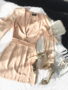 A glamorous nighttime look: The blush pink Ruffled Long-Sleeve Dress + Charlize Heel and rhinestone clutch | MARCIANO.com