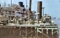 Axis passenger steamer in the North African harbor (could be Benghazi or Tripoli) during the German drive to Egypt, 1941. The picture was taken by General Erwin Rommel, commander of Afrikakorps. According to Bert SIS 5 from Axis History Forum (AHF), the truck on the left is a Lancia 3 RO, in the middle it is too difficult for to say, while on the right could be a FIAT of the 634 series