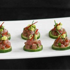 Cucumber slices with tuna and avocado tartare