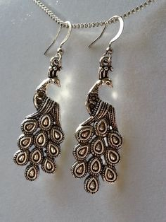 Silver Peacock on Silver Plated Ear Hooks by schmittbyhand on Etsy