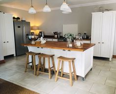 We ALWAYS recommend a wooden top on our client's kitchen islands. Wood is warm, winter or summer, it feels good to sit at a wooden island - in opposition to a cold stone top. Wooden tops also bring in an aspect of natural to your decor. It cuts through sharp lines and adds a feeling of softness and realness. Honestly, you can't go wrong with a wooden top on your island. #freestandingkitchens #kitchenisland #milestonekitchens #solidwoodislands #kitchendecor #woodenfurniture Free Standing Kitchen Units, Kitchen Decor, Kitchen Design, Wooden Island, Swedish Style, Wooden Tops, Wooden Furniture, South Africa, Solid Wood