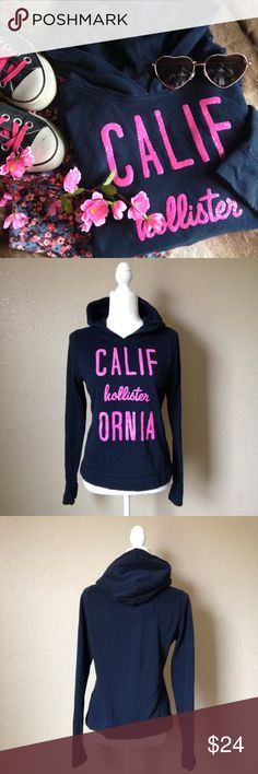 Hollister Sparkly Logo Pullover Hoodie Super cute Hollister pullover hoodie, navy blue with sparkly pink logo. Great gently used condition, size M. I accept reasonable offers 😊 Hollister Tops Sweatshirts & Hoodies