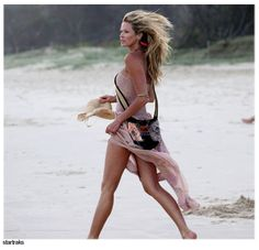 """Elle Macpherson, aka """"The Body,"""" is 47-years-old and says her secret to staying youthful is, """"to put some time aside every day to do some physical exercises. I surf, water-ski and ride horses. I mix it up."""""""