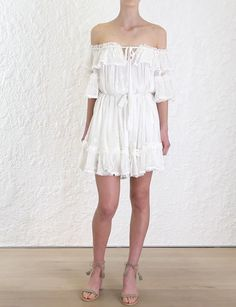 Prima Bow Frill Dress Dress, from our Resort Swim 18 collection, in Ivory embroidered silk crinkle georgette. Off shoulder mini dress with drawstring necktie detail and ruffles throughout neckline, sleeves and skirt hem. Picot edge finish on all ruffles. Comes with a separate self tie belt, fully lined.