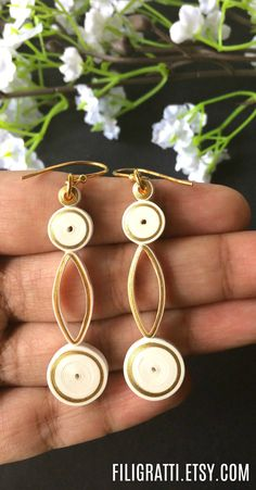 Love wearing long dangle earrings but worry about them weighing you down? These white earrings with gold accents are so lightweight, you won't even know you are wearing them, so you can party hassle free. Minimalist Earrings, Minimalist Jewelry, Minimalist Design, Bridal Jewelry, Jewelry Gifts, Gold Jewelry, Jewellery, Paper Quilling Earrings, Quilled Creations