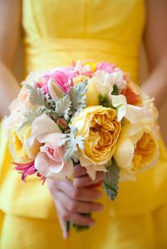 pink and yellow bouquets for bridesmaids