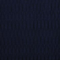 """Accordion-Pleat Silk Brocade -- Carolina Herrera brings us a stunning pleated silk fabric in deep navy. Medium-weight with what we're calling diamond accordion pleats, it has texture in spades. A really special piece; make a timeless cocktail dress or jacket. Navy, width: 42"""", Content: SILK, Designer: Carolina Herrera."""