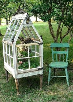 old windows make a sweet miniature greenhouse Love, love, love this! I could start seedlings outdoors!