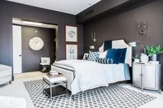 With a deep, moody charcoal color on all four walls, an inviting queen bed and smart features that make the space comfortable and user-friendly, the swanky master bedroom offers a luxurious and private retreat from the rest of the home.