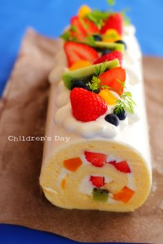 Fruit roll cake ... no recipe (it's from a Japanese blogger's site).  But I imagine that with a light sponge cake recipe, a cream cheese/whipped cream filling and cut fruit, it could be recreated very easily!  :)