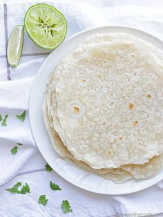This simple recipe for homemade flour tortillas has just 3 ingredients and the tortillas taste so much better than store-bought and they're cheaper too - just $1.25 for a whole batch of tortillas! I make extras and freeze them for quick dinners - that is if the family doesn't eat them all! :: DontWastetheCrumbs.com