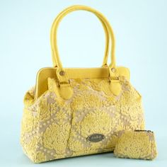Saw a lady carrying this diaper bag in starbucks today... The brand is Petunia pickle bottom..the cake line.  I love the yellow and grey combo and how girly the bag is