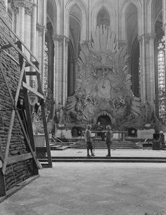 French and British soldier in front of the High Altar of the Amiens Cathedral, showing one of the piles of sandbags by which the carvings were protected, 4 May 1918