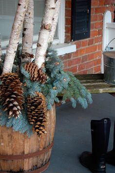 use my nail kegs. birch branches and drape pine cones over the edges..nice