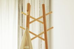 Charming Coat-Rack Gotta love this minimal coat-rack by the designers at Smartwoodhouse. Designed for easy assembly, storage, and transport, the S02 is composed of interlocking round wood pieces of different size that are connected by hidden hardware joints. Geometric shapes and lines complimented by the round, warm wood make this piece perfect for both minimal and classic atmospheres.