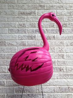 Pink Flamingo Pumpkin Make a flock of funky pink flamingo pumpkins for Halloween this year. Put them in the pumpkin patch or in the yard.