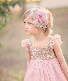 Sparkly+and+elegant,+this+chiffon+mauve+pink++flower+headband+is+a+beautiful+accessory+for+your+favorite+pippylou.com+dress+or+any+special+occasion!++Accented+with+pearls,+feathers+and+a+touch+of+glitter+and+gold.++ Available+on+a+lace+headband+(2in+wide),+skinny+fold+over+elastic+headband+(1/...