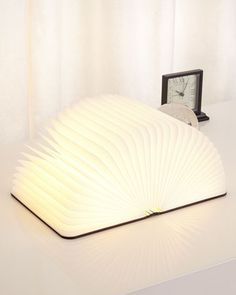 Lumio Light Book | Neiman Marcus | Dynamic, multi-functional lamp that conceals itself in the form of a hardcover book