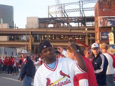 Taking in a baseball game at the old BUSCH STADIUM  while the new BUSCH STADIUM was being constructed behind me.  2006