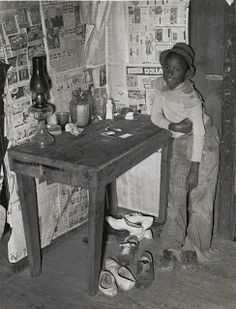 1930s sharecroppers. The migrant workers' conditions were deplorable. They lived in overcrowded, dilapidated cabins. Children followed their family and often worked full time.