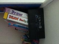 A SHOSE BOX SIMPLY TURN INTO A BOOK HOLDER GREAT IDEA