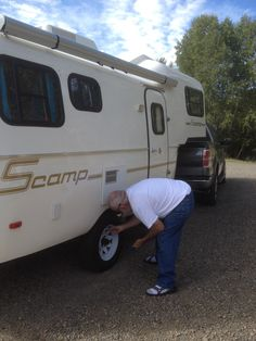 Bill checking the air pressure on the trailer tires at Pagosa Riverside RV Park and Campground over Labor Day week end, Travel Trailer Tires, Rv Parks And Campgrounds, Us Travel, Recreational Vehicles, Travel Photos, Travel Pictures, Camper, Campers, Single Wide
