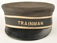 Railroad Uniform Cap with early Trainman rope style lettering. Consignor states Illinois Central or Milwaukee Road as the line. Manufacturer marked Pantke-Harpke Co. 632 No. Water St Milwaukee Wis. Size Unmarked size: unmarked